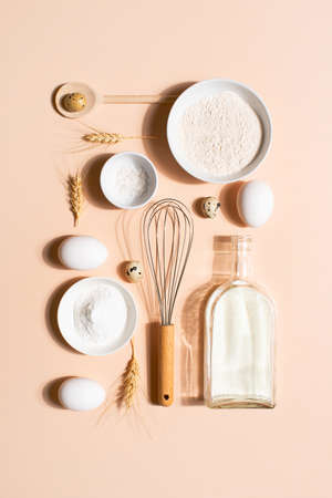 Raw ingredients for pancakes on the beige table, top view