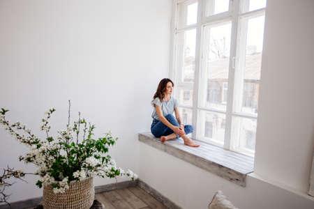 Beautiful girl by the window.