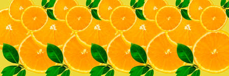Sliced orange on a bright orange background. Oranges in the panoramic image. Panorama, a banner with space for text or insertion. Pieces of citrus fruit. Template for creative and graphic works