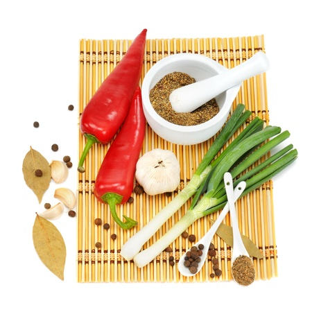 Vegetables and spices isolated on white background photo