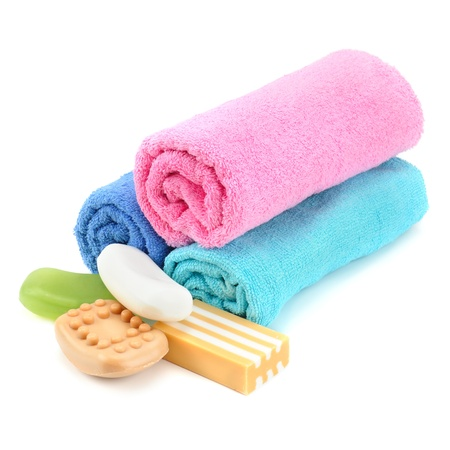 Stack of towels and soap isolated on white background