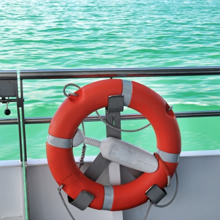 life preserver on the deck of a ship photo
