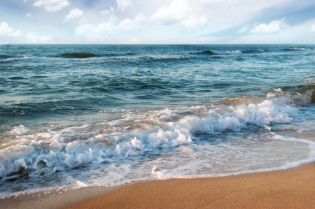 sandy beach and beautiful ocean waves Stock Photo