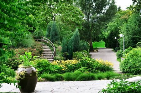 flowerbeds: Park with beautiful avenues, flowerbeds and shrubs Stock Photo