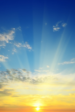 sunset sunrise: the sun rays illuminate the sky above the horizon Stock Photo