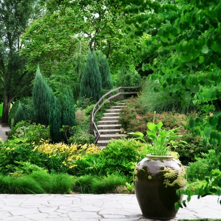 Park with beautiful avenues, flowerbeds and shrubs photo