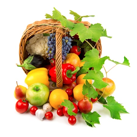 vegetables and fruits in a basket isolated on white background Standard-Bild