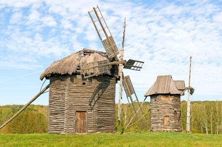 Old wooden windmills on the background of the autumn forest Stock Photo - 15985684