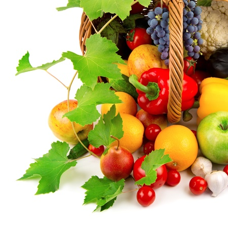 vegetables and fruits in a basket isolated on white background Stock Photo - 16169368