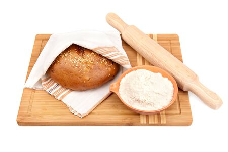 bread and kitchen utensils on a white background photo