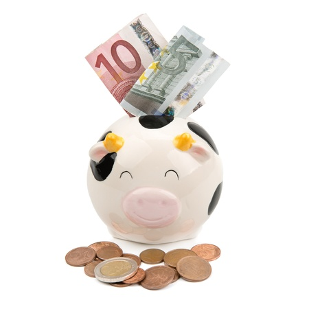 caretaking: piggy soft money and coins Stock Photo