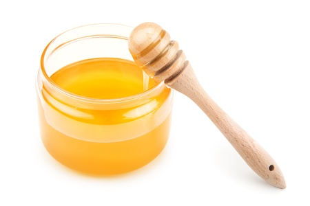 pot with honey and drizzler isolation  on a white background photo