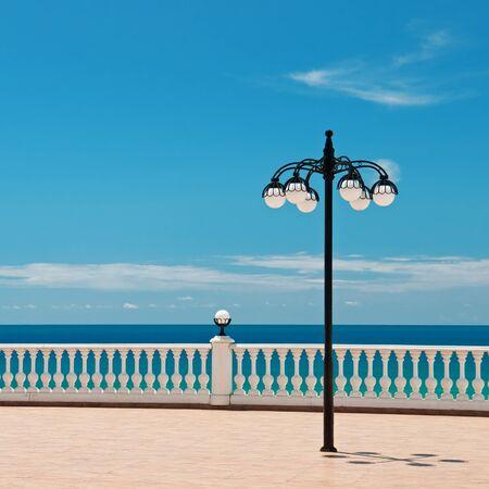 beautiful promenade with lanterns and white railings photo