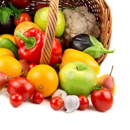 fruits and vegetables in a basket isolated on white background photo
