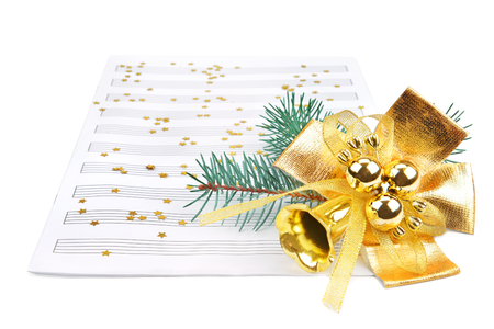 Christmas decorations and music sheet isolated on white background
