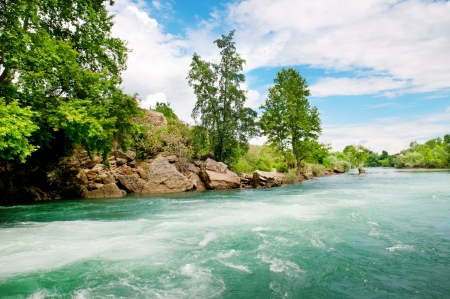 rocky coast river and the blue sky