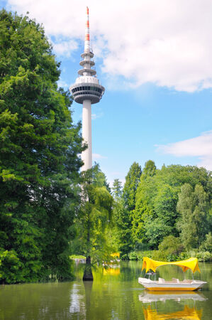 television tower, lake, park, boat photo