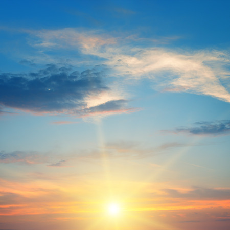 the sun rays illuminate the sky above the horizon Stock Photo