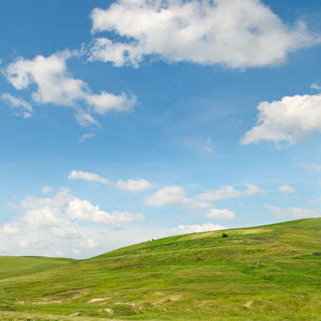 picturesque hills against the blue sky photo