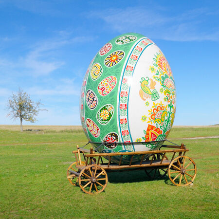 lea: big easter egg on a cart in the open air