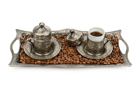 Turkish cup and coffee grain isolated on white background photo
