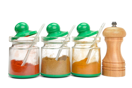 spices in jars and mill isolated on white background photo