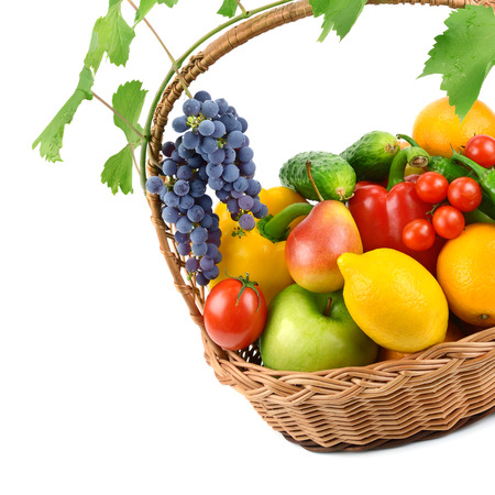 vine pear: fruits and vegetables in a wicker basket isolated on white background