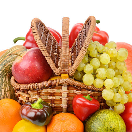 vegetables and fruits in a basket isolated on white background photo