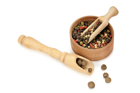 spices, scoop and bowl isolated on white background photo