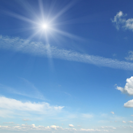 sunny season: sun on blue sky with white clouds