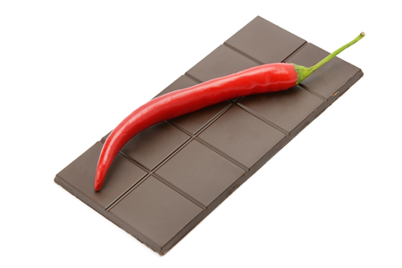 bar of chocolate and chili pepper isolated on white background photo