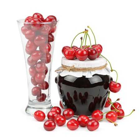 cherries and jars of jam isolated on a white background photo