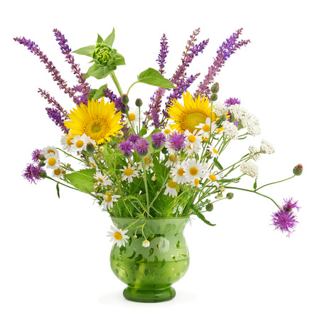 wild flowers in a vase isolated on white background photo