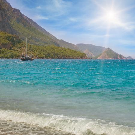 mountainous: seascape, blue sky and mountainous coast