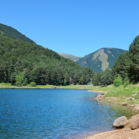 tourism in andorra: picturesque lake, mountains and blue sky