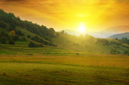 sunny sky: beautiful mountain landscape and sunrise Stock Photo