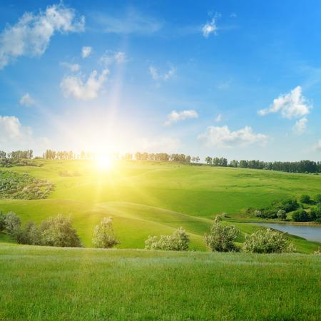 uprise: field, sunrise and blue sky Stock Photo