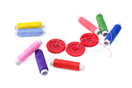 cotton thread: sewing thread and buttons isolated on white background