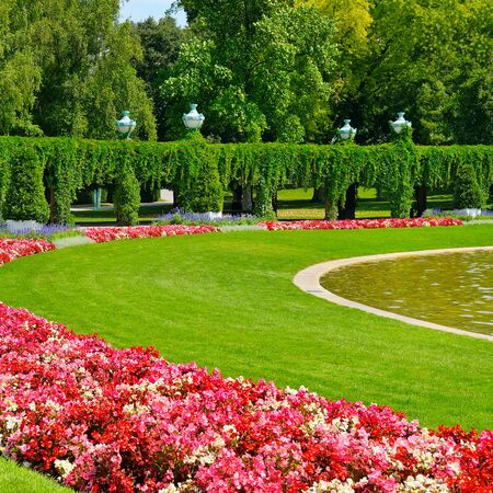 plafond: summer park with flower bed and green lawn