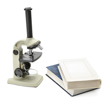analytic: laboratory microscope and books isolated on white background