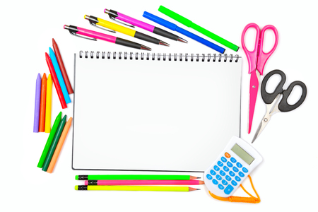 Notebook, colored pencils, crayons, markers, ballpoint pens and scissors, isolated on white, background,