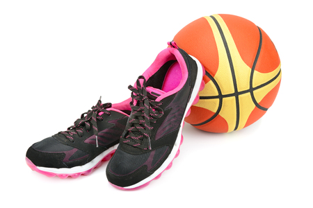 sports sneakers and basketball isolated on white background Stock Photo