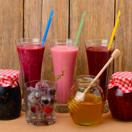 jams: Set of berry smoothies, jams and frozen berries
