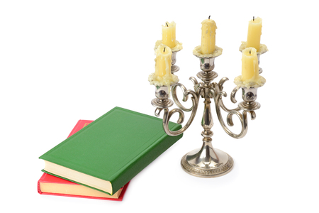 sconce: sconce with candles and books isolated on white background