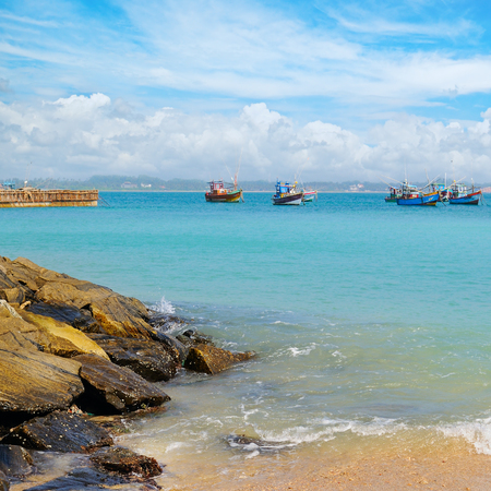 beautiful seascape with fishing boats on the water Stock Photo