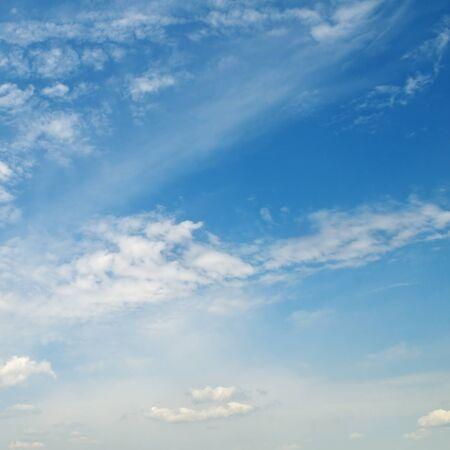 light cumulus clouds in the blue sky