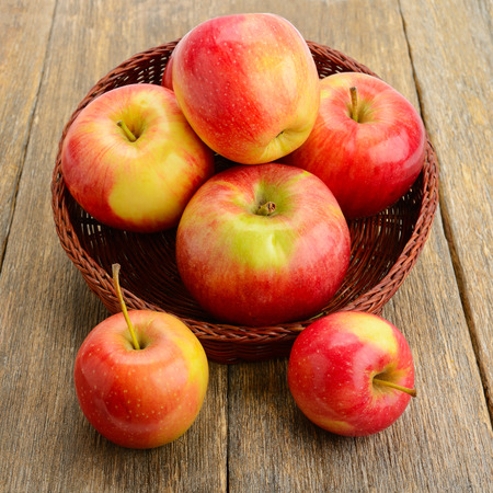 flesh colour: red apples on a wooden surface Stock Photo