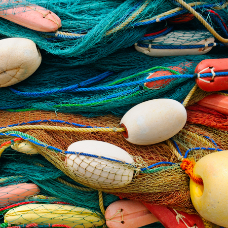 background of colorful fishing nets and floats Stock Photo