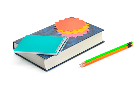 Book, pencils, notebook and stickers isolated on white background