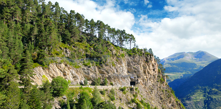 Mountains of the Pyrenees, high-altitude road and tunnel. Wide photo. Stock Photo